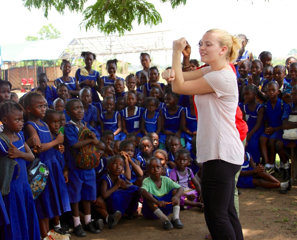 Shona Roebuck leading Kenema Primary School Children in Song