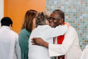 annual conference 2019, ordination, hug, embrace