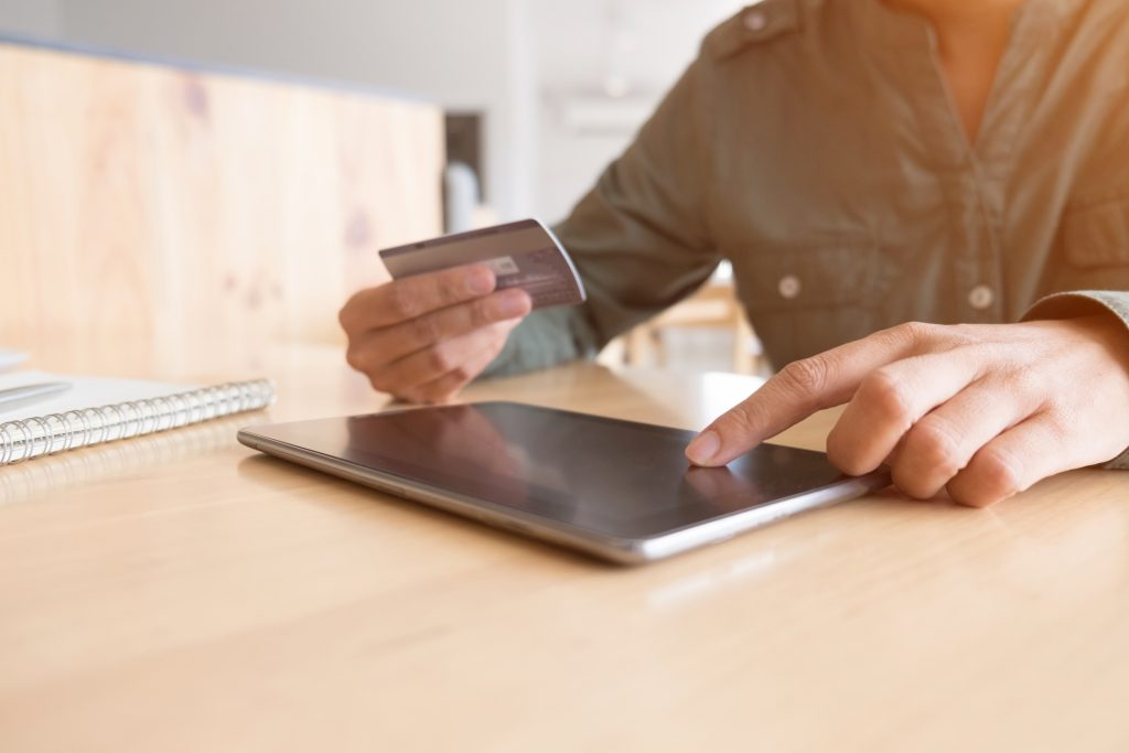 woman shopping online with laptop and credit card, sale and shop